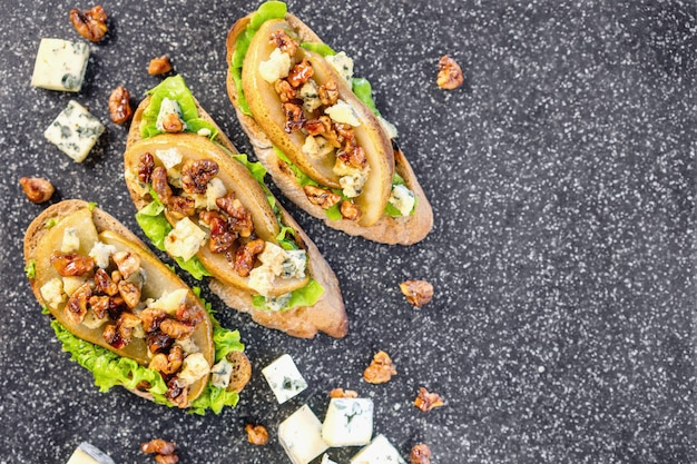 Bruschetta with pear, honey, walnut, cheese, green salad and olive oil