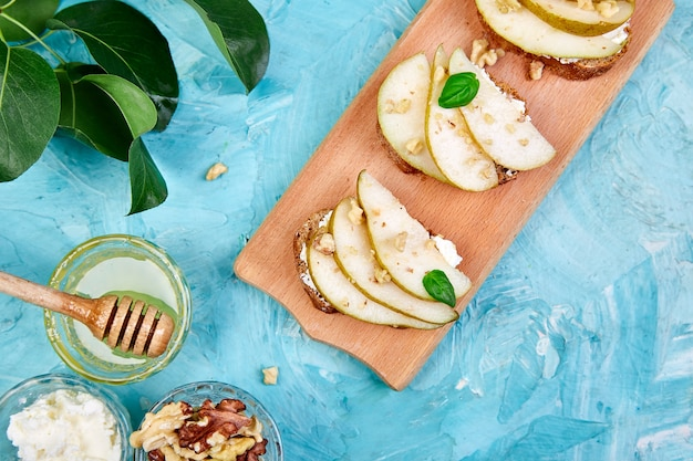 Bruschetta with pear, ricotta cheese, and honey