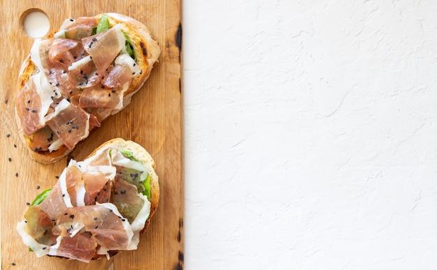 Bruschetta with prosciutto and serrano ham