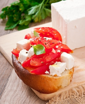 Bruschetta with tomato, feta and basil