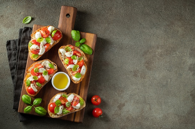 Bruschetta with tomatoes, mozzarella and basil.