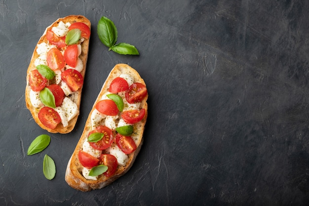 Bruschetta with tomatoes, mozzarella cheese and basil.