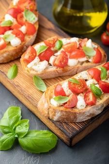 Bruschetta with tomatoes, mozzarella cheese.