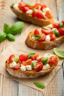 Bruschetta with tomatoes, mozzarella cheese.