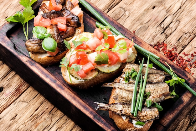 Bruschetta with various toppings.