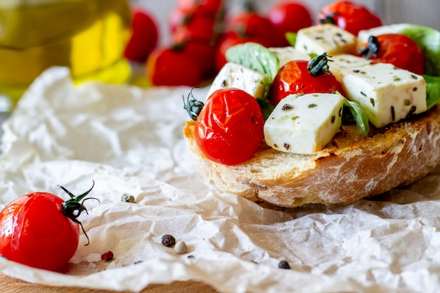 Bruschettas with tomatoes and cheese.