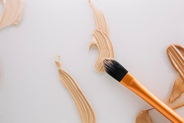 Brush on concealer stroke