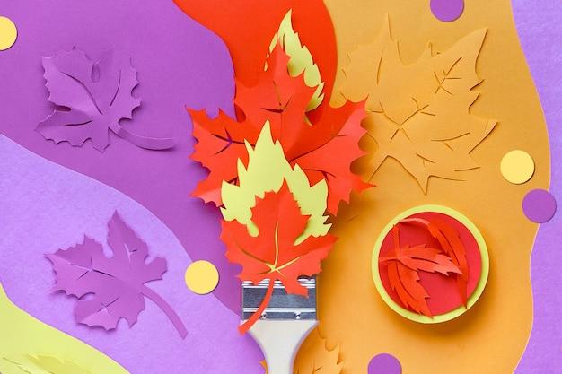 紙で作られた絵の具を載せたブラシ紅葉