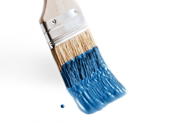 Brush in paint classic blue color of the year 2020. concept of change and renovation isolated