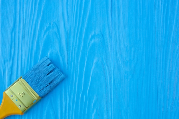 A brush painted on a blue .