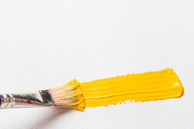 Brush painting with yellow color
