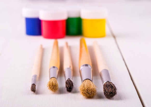 Brush set for artist and jars with a paint