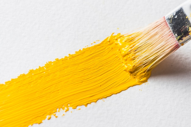 Brush smearing bright paint