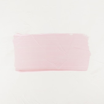 Brush stroke. acrylic paint stain. pink color stroke of the paint brush isolated on white