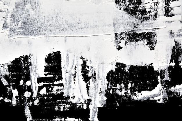 黒の背景に白い油絵の具のブラシストローク-抽象的な構成