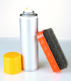 Brush for suede shoes and aerosol paint spray, on white