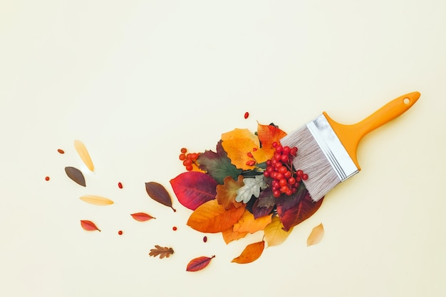 Brush with colorful autumn leaves