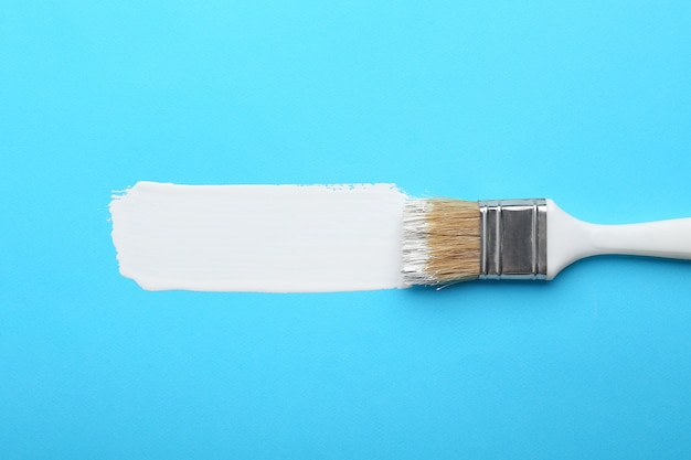 Brush with paint stroke on color background