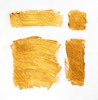 Brush with particles of gold texture various shapes