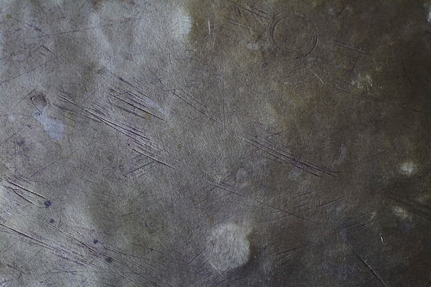 Brushed brass plate background texture, metal surface with scratches and dents