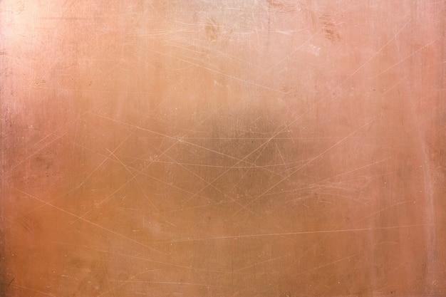 真ちゅうの起毛面、銅のテクスチャの古いプレート
