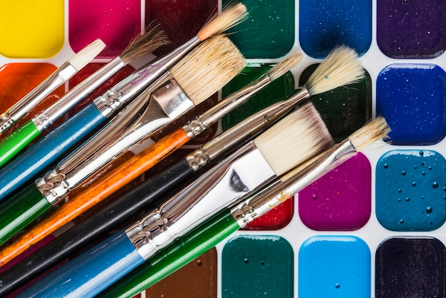 Brushes on bright watercolor