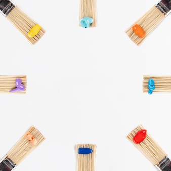 Brushes circle with colorful paints