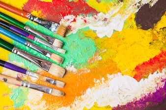 Brushes on colorful painting