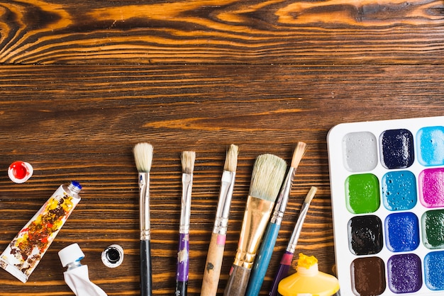 Brushes and paints on table
