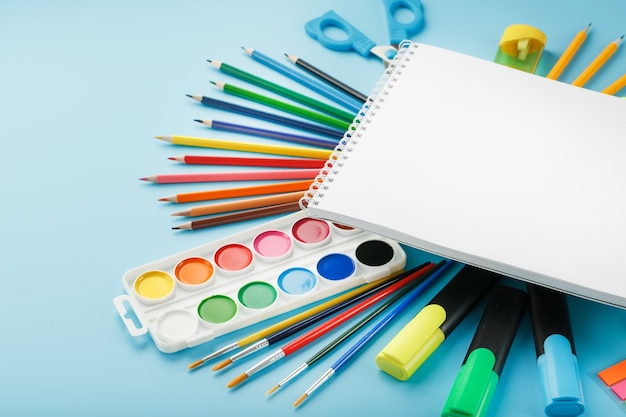 Brushes and paints with school supplies