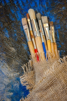 Brushes and palette with paints