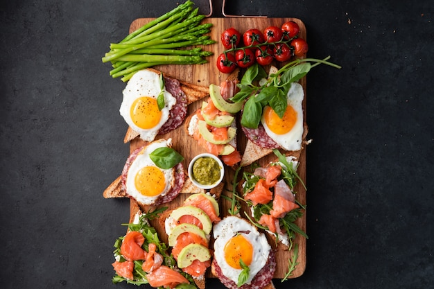 Brushetta or sandwich set on the board over black concrete