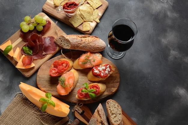 Brushetta or traditional spanish tapas. variety of small sandwiches