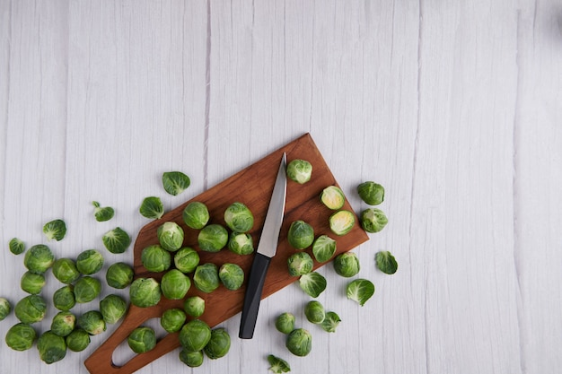Brussel sprout over rustic wooden texture. top view.
