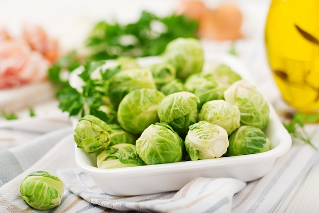 Brussels sprouts. preparation for roasting brussels sprouts with bacon.