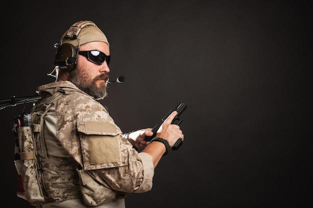 Brutal man in the military desert uniform.