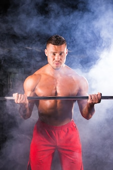 Brutal strong athletic men pumping up muscles workout bodybuilding concept