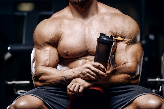 Brutal strong bodybuilder athletic fitness man pumping up abs muscles workout bodybuilding concept