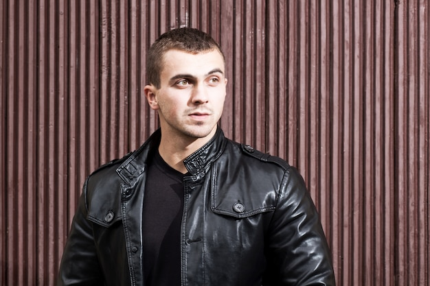 Brutal young man in a leather jacket
