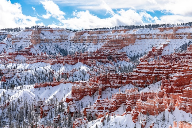 Bryce canyon, utah, usa at winter time with snow at mountains and red rocks
