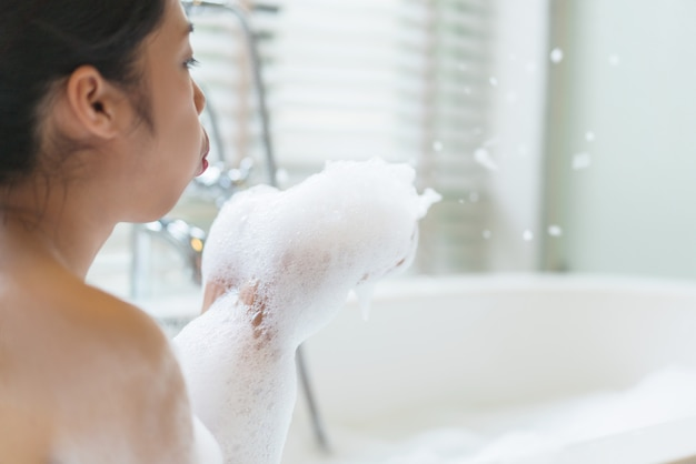 Bubble girl blowing soap bubble