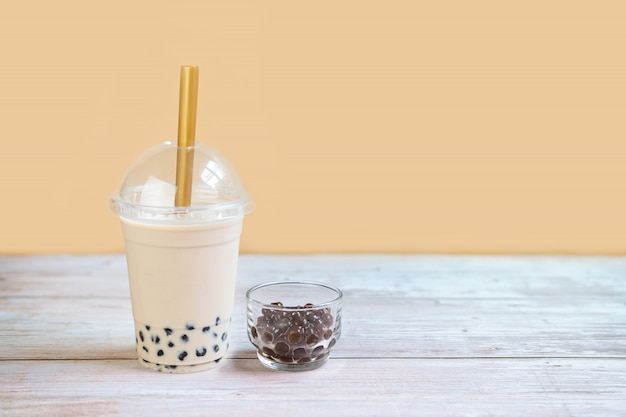 Bubble milk tea on wooden table with copy space