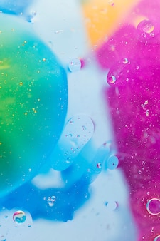 Bubbles over the colorful watercolor paint
