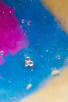 Bubbles over the pink; blue and beige background