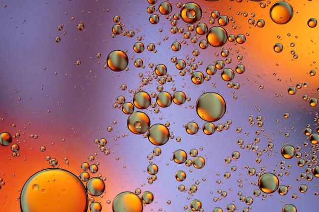 泡の世界のカラフルなマクロ要約水面の背景の背景