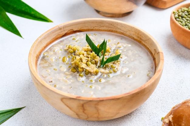 Bubur kacang hijau. javanese dessert porridge of mung beans with coconut milk. served in an earthenware bowl. a popular starter food for breaking the fast during ramadan