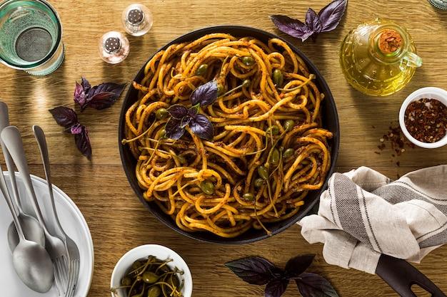Bucatini pasta with sicilian almond pesto. traditional vegan italian cuisine