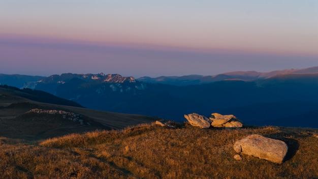 Bucegi, amazing summer sunrise with beautiful orange lights on summit montains