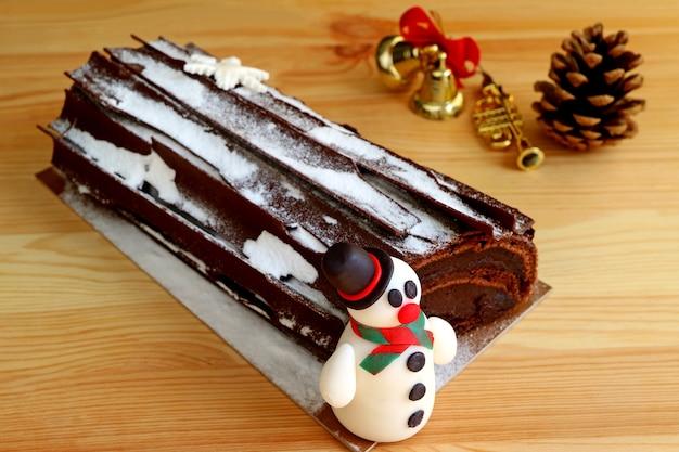 Buche de noel cake on wooden table