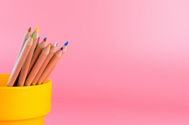 Bucket of color pencil with pink copy space